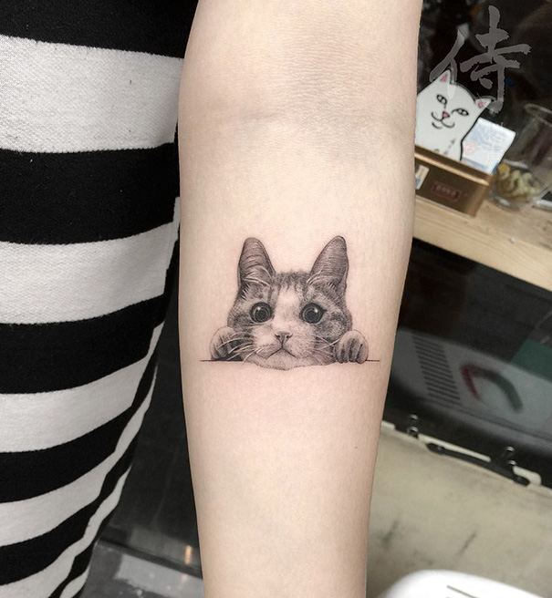 Super cute cat tattoo, which one do you like best?